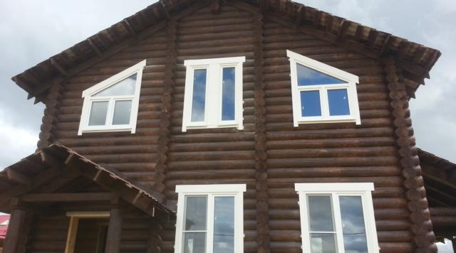 Монтаж окон, установка входных дверей в бревенчатых строениях